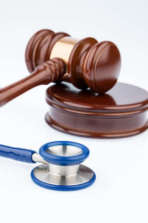 botch: gavel and stethoscope, symbol photo for bungling and medical error Stock Photo