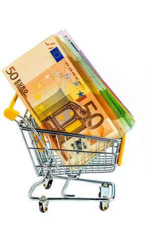 consumerist: euro banknotes in a shopping cart, photo icon for purchasing power, shopping, money printing and inflation Stock Photo
