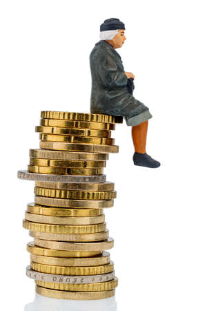 pensions: pensioner sitting on a pile of money, symbol photo for pensions, retirement, pension