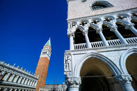 st  mark's square: the campanile in st. marks square in venice, italy. landmark of the city with the doges palace (right)