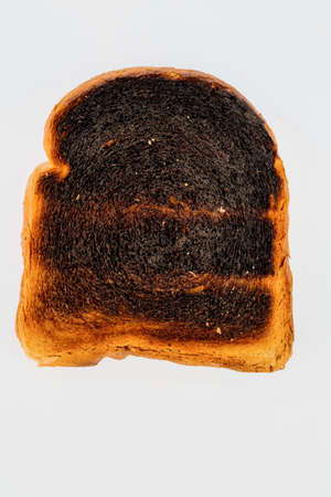 toast: toast was burned during toasting. burnt toast at breakfast. Stock Photo