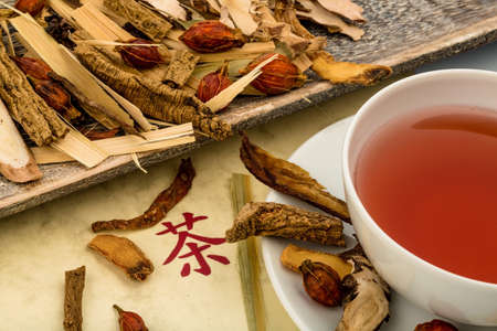 therapie: ingredients for a cup of tea in traditional chinese medicine. curing diseases through alternative methods.