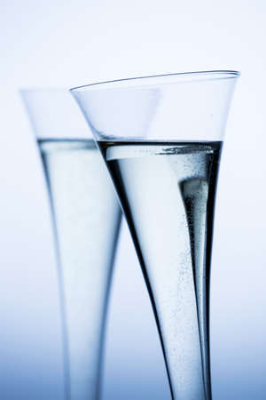 alcoholic drink: champagne or sparkling wine in a champagne glass. photo icon for celebrations, new year and good humor