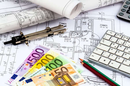 financed: a blueprint of an architect with euro money. symbolic photo for financing and planning of a new house. Stock Photo