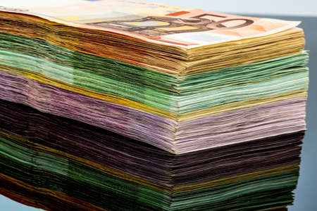 invest: many different euro bills. symbolic photo for wealth and investment