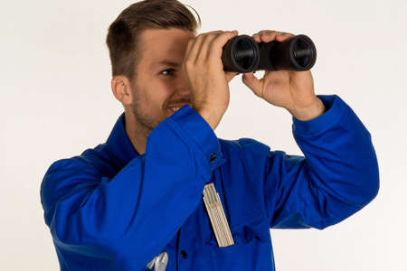 investigated: a worker in a business enterprise (craftsmen) with binoculars looking for jobs or jobs