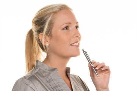 a pensive young woman with a pen. business creation and business idea Stock Photo