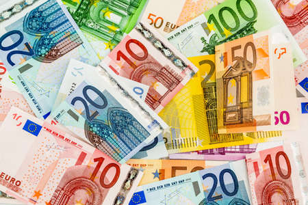 tax bills: many different euro bills. symbolic photo for wealth and investment.
