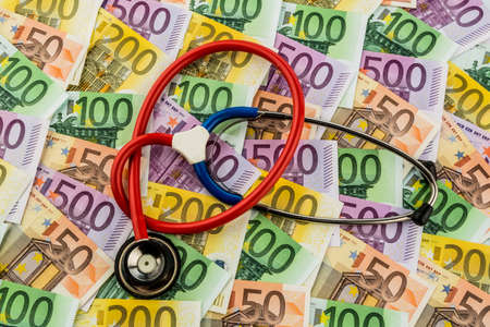 pracitioner: stethoscope and euro banknotes. symbol photo for costs in healthcare and health insurance and for medicine Stock Photo