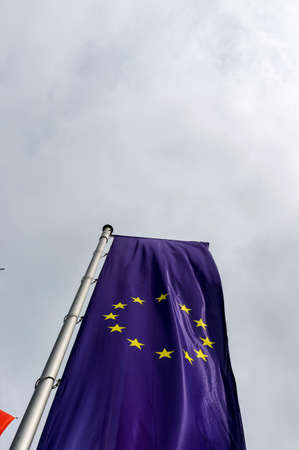 diplomacy: european flag and other flags, symbolism of diplomacy and international cooperation