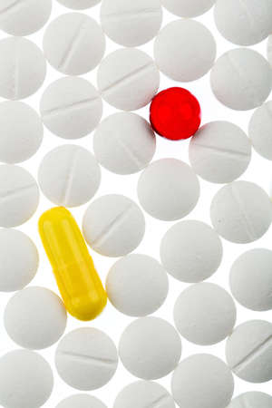 sleeping tablets: white and colored tablets symbolfoto for medicine, cures and painkillers