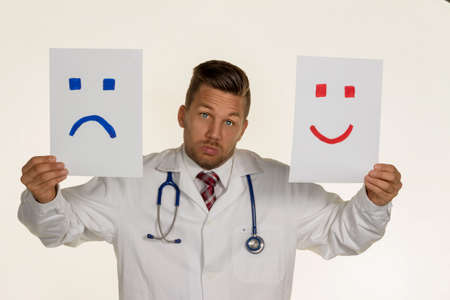 joie: a doctor can not decide if he should laugh or cry Stock Photo