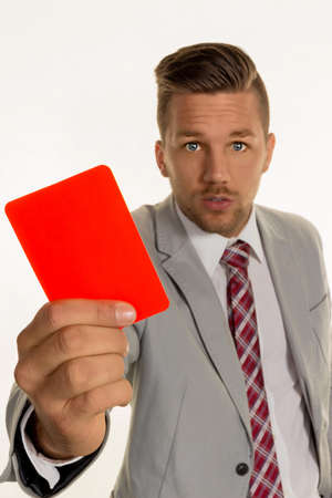 dimissal: a manager holding a red card in hand. symbolic photo for resignation or dismissal Stock Photo