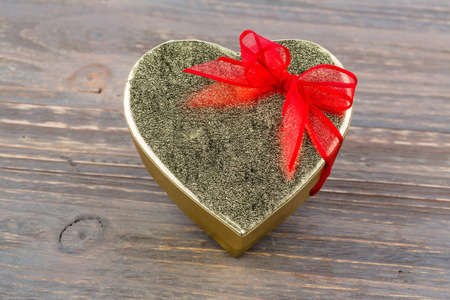 cordially: a box for a gift in the form of a heart. symbolic photo for valentines day, wedding, engagement.