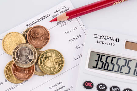 subsistence: the bank statement and some coins of euro currency Stock Photo