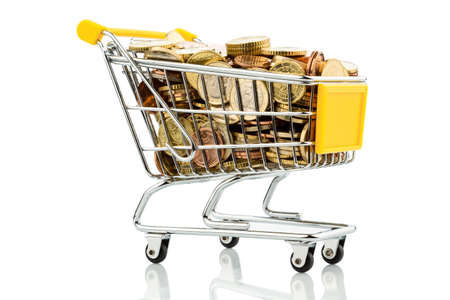 consumerist: a shopping cart is well stocked with euro coins photo icon for purchasing power and consumption Stock Photo