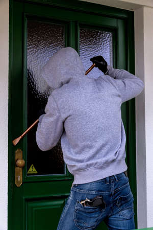 criminal case: a burglar trying to break a door.