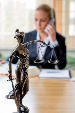 court process: businesswoman sitting in an office. symbol photo for managers, self or lawyer.