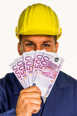 illegally: a worker in a business enterprise with banknotes in his hand