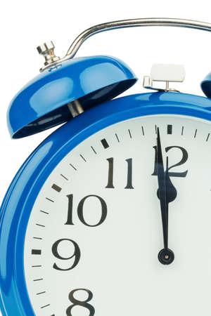 hour hand: a blue alarm clock on a white background. eleventh hour