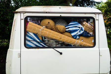 overloaded: belongings in a van, symbol photo for relocation and vacations