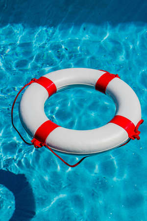 credit crisis: an emergency tire floating in a pool. symbolic photo for rescue and crisis management in the financial crisis and banking crisis.