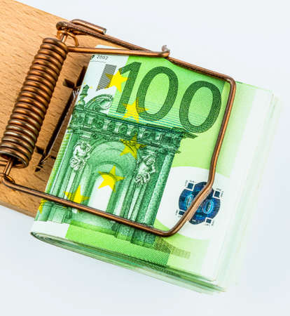 loans: many euro banknotes in a mousetrap. symbolic photo for debt and debt on loans. Stock Photo