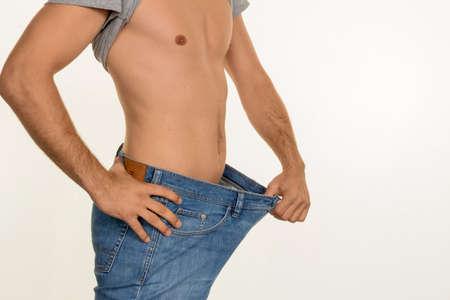 een mens gehaald met een succesvol dieet veel lichaamsgewicht. Stockfoto