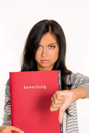 collectives: a young woman holding a folder for the application in an open job in hand.