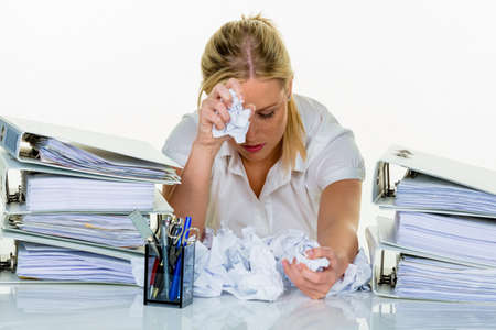 burnout: young woman in office is overwhelmed with work. burnout at work or study.