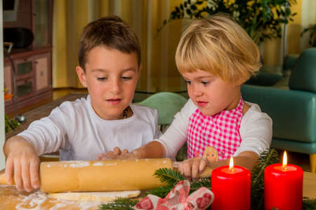children baking cookies for christmas. cookies for the holiday season