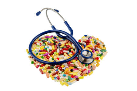 heart failure: stethoscope and pills in heart shaped arrangement, symbol photo of heart disease, diagnosis and medication