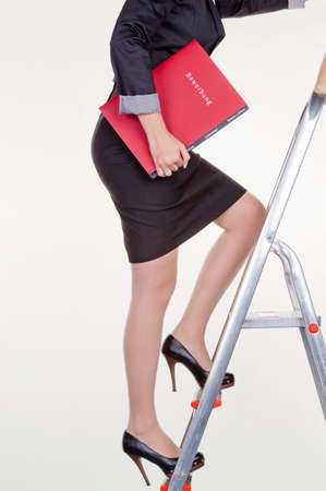 a woman in business clothing with application portfolio. proper clothing for the interview.