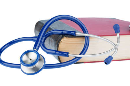 physicans: book and stethoscope, symbol photo for bungling, doctors mistakes and expertise Stock Photo