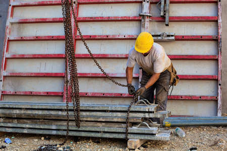 botch: construction workers at the construction site of a new company and building industry Stock Photo