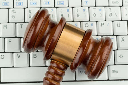 consumer rights: gavel on computer keyboard, symbol photo for e-commerce and consumer protection