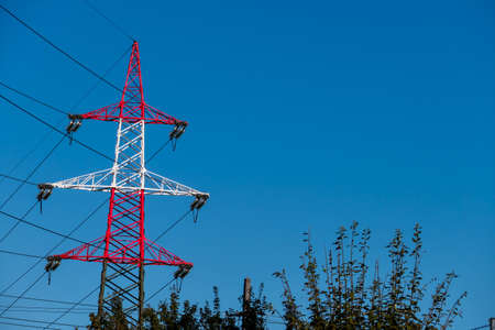electromagnetic: pylon red and white, a symbol of power, power supply, electromagnetic pollution Stock Photo