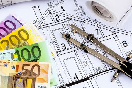 immobilien: a blueprint of an architect with euro money. symbolic photo for financing and planning of a new house. Stock Photo