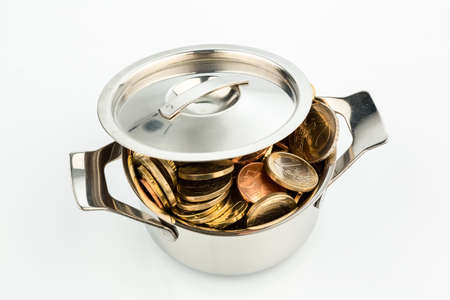 stocked: a pressure cooker is well stocked with euro coins photo icon for funding Stock Photo
