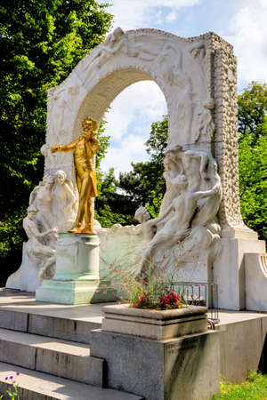 memorial: the johann strauss monument stands in the vienna city park.