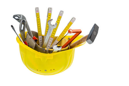 botch: hand tool in a protective helmet, symbol photo for crafts, construction, home improvement Stock Photo