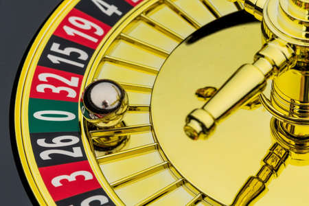 decided: the cylinder of a roulette gambling in a casino. winning or losing is decided by chance. number zero, lost everything