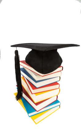 apilar: una Junta de mortero sobre una pila de libros, fotografía simbólica de la educación y la competencia