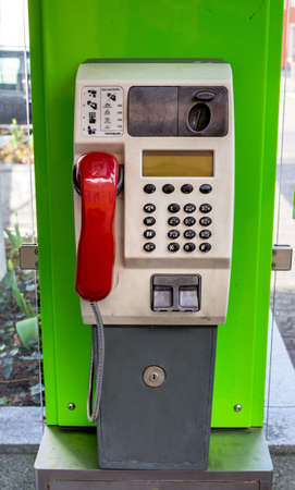 cell phone booth: a phone booth of telekom austria with a red telephone handset