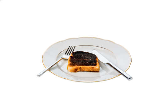 scorch: toast was burned during toasting. burnt toast at breakfast. Stock Photo
