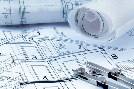 construction draftsman: a blueprint of an architect for the construction of a new residential building. symbolic photo for financing and planning of a new house.