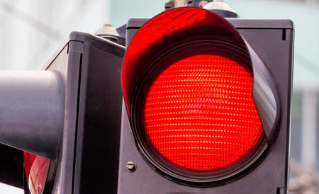 control panel lights: a traffic light shows red light. symbolic photo for grip end.