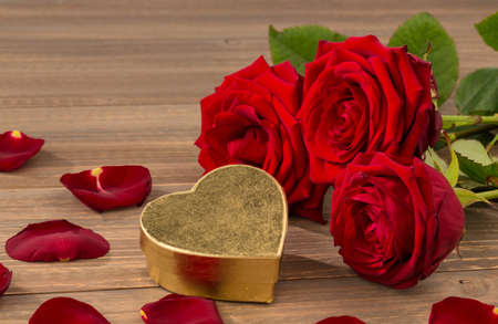 feast day: roses as a gift and surprise to a feast. symbol photo for birthday, mothers day, love, valentines day Stock Photo