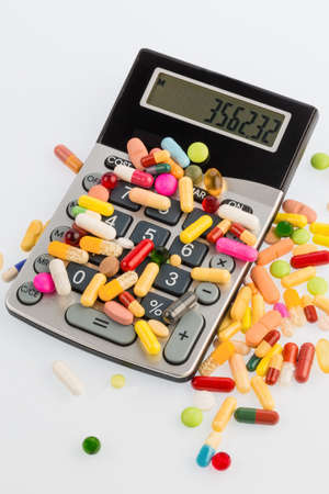 therapie: many colorful pills on a white background. symbolic photo for medicine and drugs