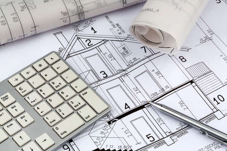 immobilien: a blueprint of an architect for the construction of a new residential building. symbolic photo for financing and planning of a new house.
